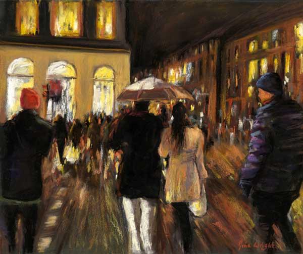 People walking in the rain towards lighted buildings