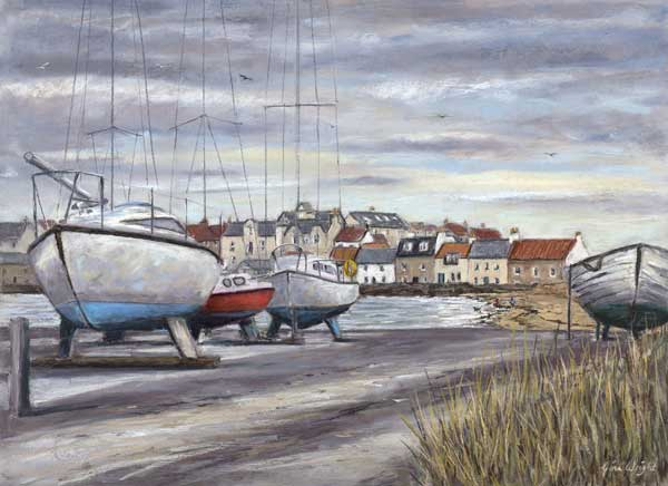 Boats on the harbour side, lifted out for winter