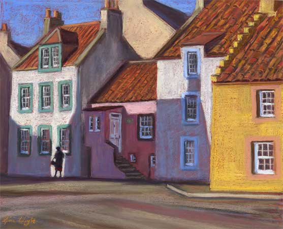 Lady walking past coloured houses in sun and shadows